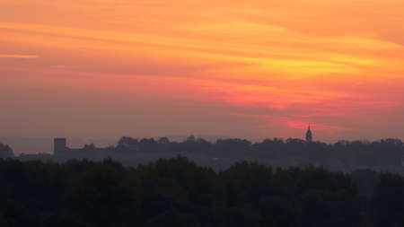 Colorful Panorama of Belgrade City and Danube River Bank at Sunrise in Timelapse with Dramatic Atmosphere due to Orange Red and Yellow Sky and Clouds. High quality 4k footage