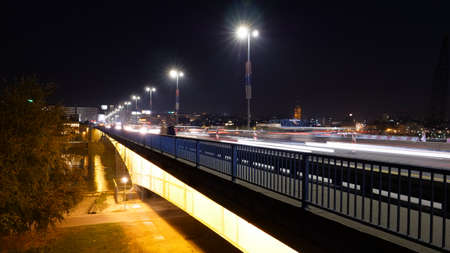 Night Timelapse, made with Long Exposure Pictures, of Cars and Vehicles with Light Trails over the Brankos Bridge (Brankov most) in Belgrade Serbia over the Sava River Water