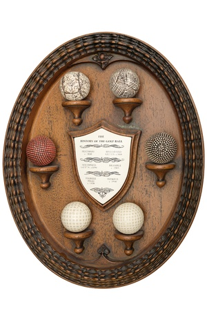 wooden object that tells the story of golf balls Stock Photo