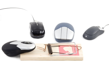 computer mouse about to be caught in a mousetrap while others look Stock Photo