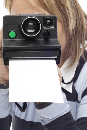 woman holding an old camera where you leave a photo in white Stock Photo - 10902076