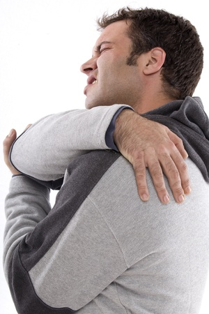 pained: boy touching the back with a pained expression on his face Stock Photo