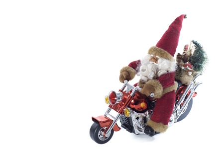 santa claus standing on a motorcycle on a white background Stock Photo