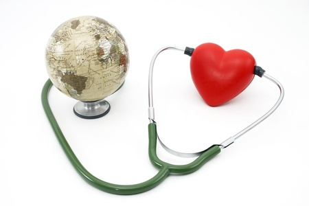 red heart beat listening to the earth with a stethoscope Stock Photo
