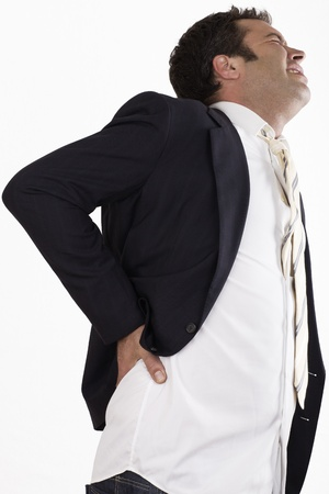 businessman with back pain and sick face photo
