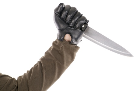 a black gloved hand holding a knife Stock Photo
