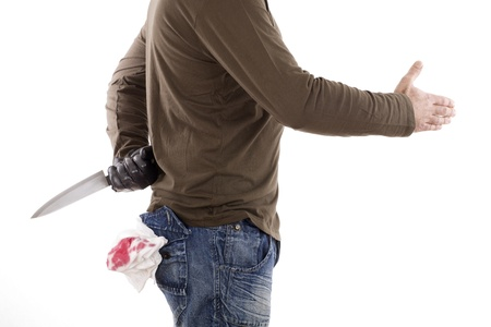 man hiding a knife behind his back while offers a handshake Stock Photo - 11472083