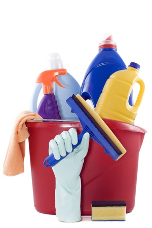 bucket full of cleaning products on a white background photo