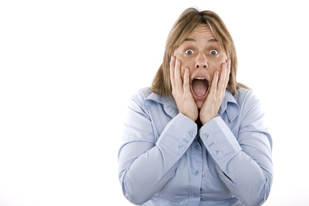 woman with hands on face and mouth open in surprise Stock Photo - 11472170
