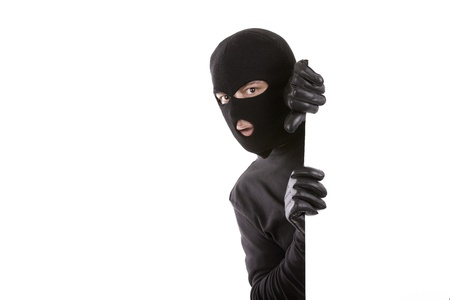 masked man appearing on one side with an expression of surprise