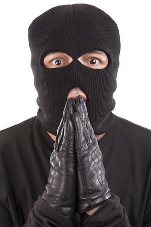 excuser: s'excusant voleur avec une expression de chagrin