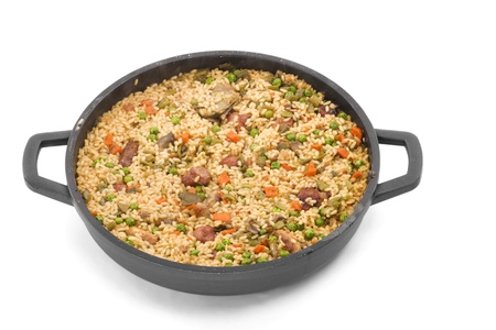 paella made ??with rice and vegetables to the pan, on a white background Stock Photo