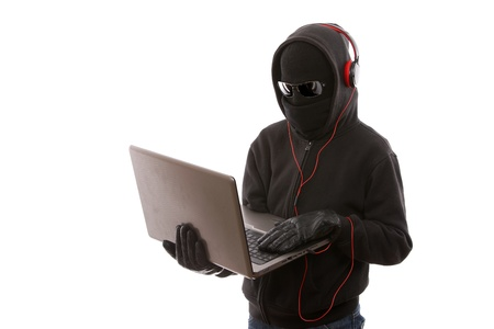 masked thief illegally downloading music from your computer