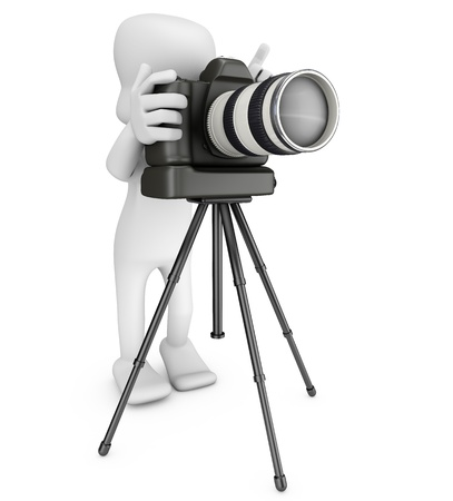 photographer looking behind a camera attached to a tripod, ready to take a picture Stock Photo