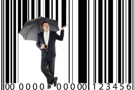 businessman under one umbrella, in between a large barcode, metaphor boss, manager, consumerism     photo