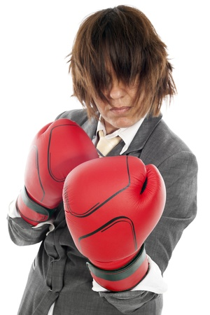 business woman about to fight in defense position and the hair covering her face photo