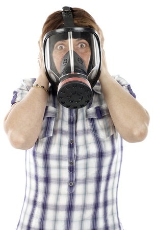 woman with a gas mask covering his ears with the frightened face photo