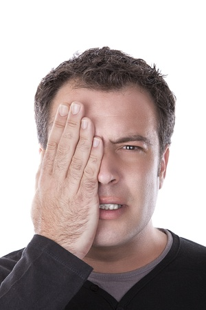 man covering his eye with his hand, as if in an ophthalmic photo