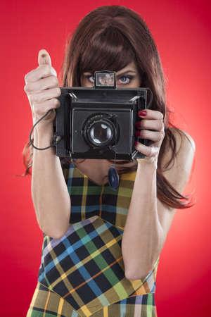 pin up girl shooting an old photo camera photo