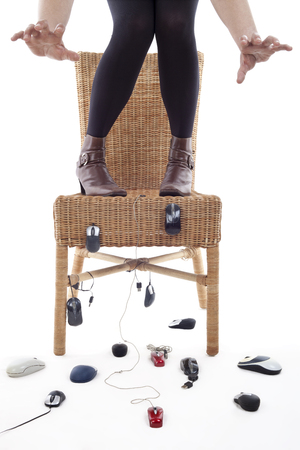 rise to a chair woman being attacked by computer mice, metaphor of phobia