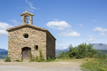 hermitage: Romanesque hermitage of Sant Salvador de Irgo, Lleida (Spain) Background: sky, clouds, mountains and vegetation