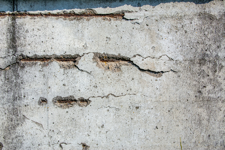 visible: Concrete Texture (concrete slab). Concrete structure capture with visible metallic rusted fittings. Stock Photo