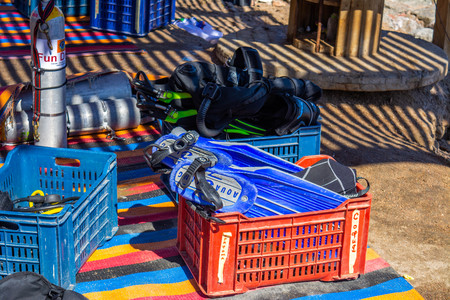 Diving equipment on the beach. flippers, masks, tubes, diving cylinders. Egypt, Dahab, 09.03.2019.