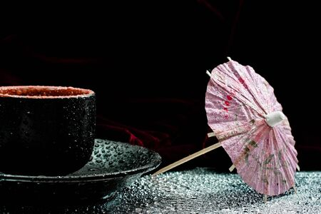 little cup for drink in relax. Red background and drops Stock Photo - 10856369