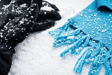 Gloves and a scarf over the snow for winter Stock Photo - 11646176