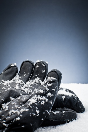 Gloves over the snow