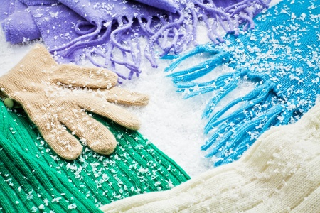 gloves and scarves of wool over the snow