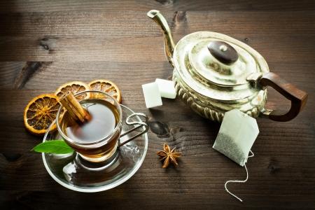 brown cup tea: hot tea and old tea pot  Stock Photo