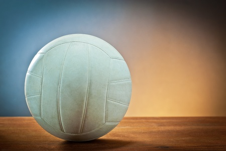 Sports equipment.Volleyball on wood
