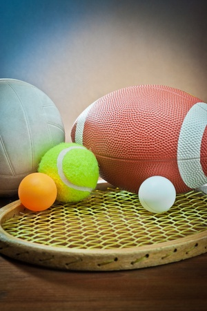 sporting equipment: Assorted sports equipment.Tennis and racket,rugby and volleyball