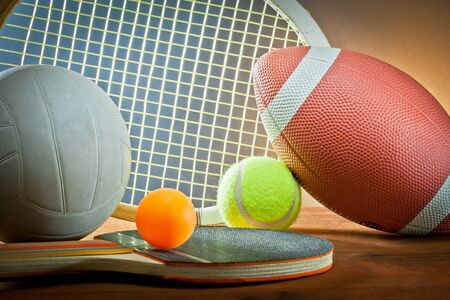 Assorted sports equipment.Tennis,rugby,volleyball and table tennis