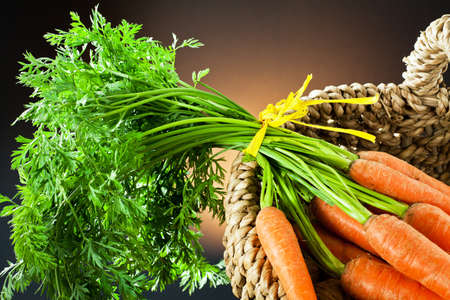 nuts and carrots in the basket Stock Photo - 12121900
