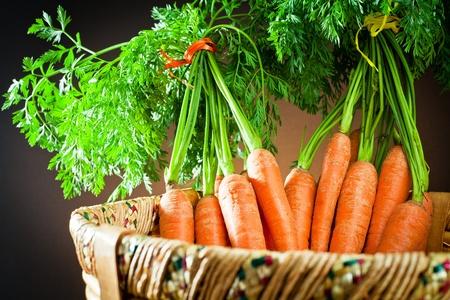 Bunch carrots in wooden basket
