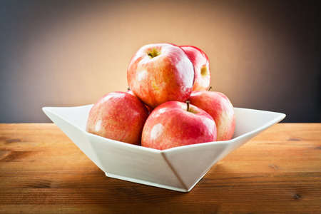 red apples on white tray  photo