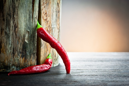 red hot chilli pepper on wood  photo