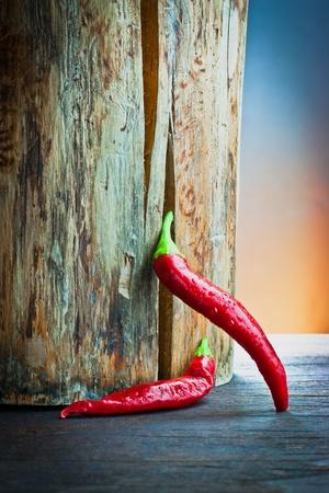 red hot chilli pepper on wood  Standard-Bild