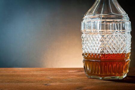 amber coloured: liquor in bottle of glass antique  Stock Photo