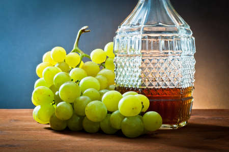 pissed: grapes,wine and bottle liquor  Stock Photo