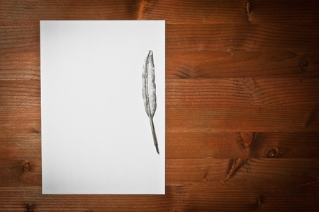 paper white and ancient pen on wood  photo