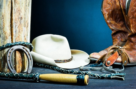 barn boots: Cowboy boots,horseshoe,whip,spurs and hat on wood