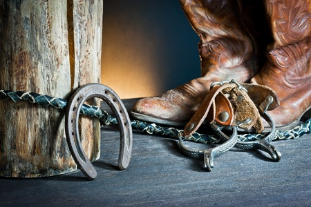spurs: Cowboy boots,horseshoe,whip and spurs on wood