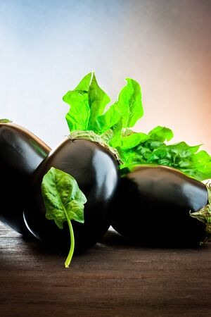 aubergine and spinach on wood  photo