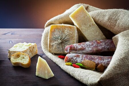 assortment of cheese and salami  photo