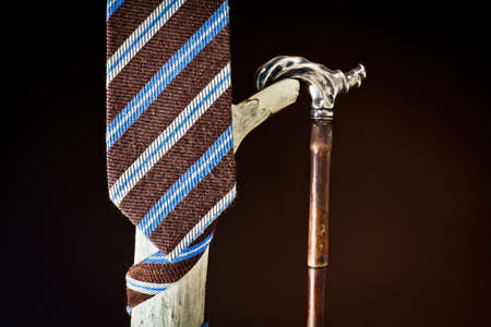 cane collar: cravat and stick to old age
