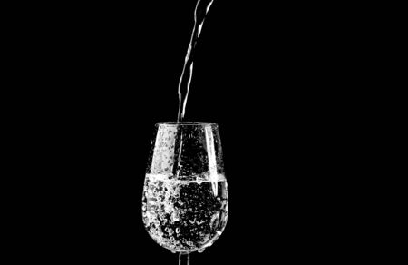 purified: pour water into the glass  Stock Photo