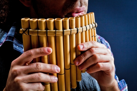 concert flute: Panflute old played in his hand Stock Photo
